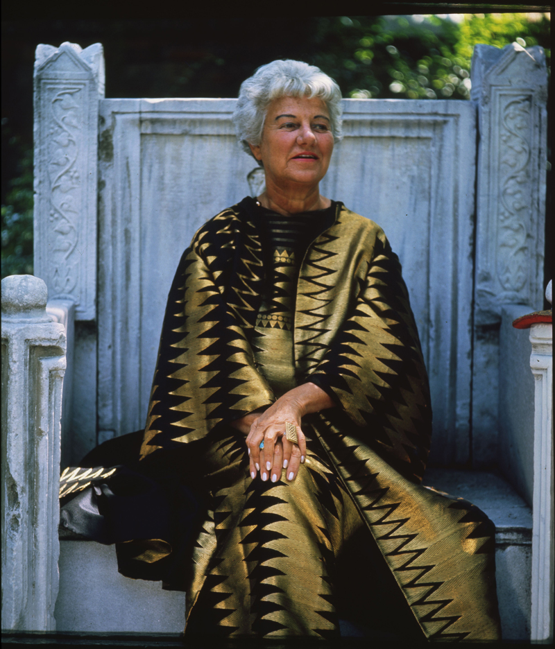Peggy Guggenheim sitting on the throne in the garden of Palazzo Venier dei Leoni, Venice, 1960s. Photo Roloff Beny / courtesy of Archives and National Archives of Canada